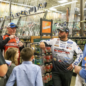 Major League Fishing pros Mark Davis and Cliff Crochet mingle with fans.
