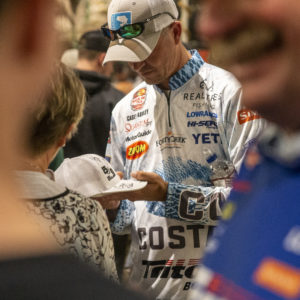 Major League Fishing pro Casey Ashley signing an autograph.
