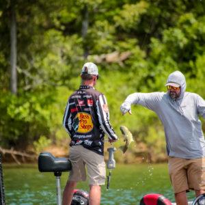 Greg Hackney boat flips a bass. Photo by Phoenix Moore.