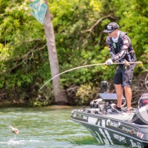 Brent Ehrler reeling in a fish. Photo by Phoenix Moore.