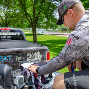 Bradley Roy wiping down his Lowrance Electronics in preparation for his Elimination Round.