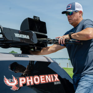 Lane keeps extra rods stashed in sleeves that are attached to his Yakima Truck Rack.