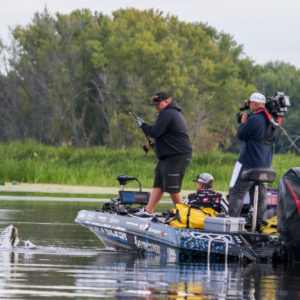 Jacob Powroznik lands a bass. Photo by Jesse Schultz