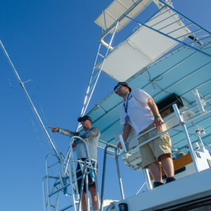 Jonathon VanDam looks for fish from the second level of the offshore fishing boat. Photo by Rachel Dubrovin.