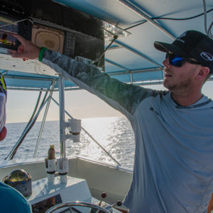 Jonathon VanDam checks out the graph after traveling several miles offshore. Photo by Rachel Dubrovin.