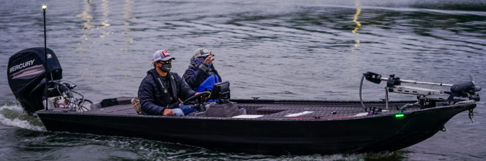 Poche and his co angler taking off in his aluminum boat on Championship Saturday.