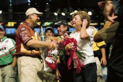 George Cochran is congratulated by his wife, Debi, and other FLW Tour competitors after winning the 2005 Forrest L. Wood Championship.
