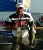 Pro Bill Walker shows off his two biggest fish from day one on the Mississippi River. Walker finished the day in fourth place.