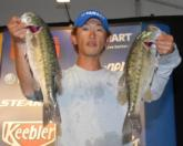 Masahiro Yanase of Nagoya, Japan leads the Co-angler Division of the FLW Tour event on Lewis Smith Lake with a five-bass limit weighing 11 pounds, 12 ounces.
