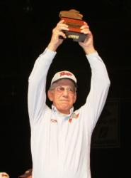 Bemidji, Minn., co-angler Lowell Joy holds up his trophy for winning th 2009 FLW Walleye Tour Championship.