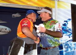Second-place co-angler Bo Standley congratulates Keith Honeycutt on his win.