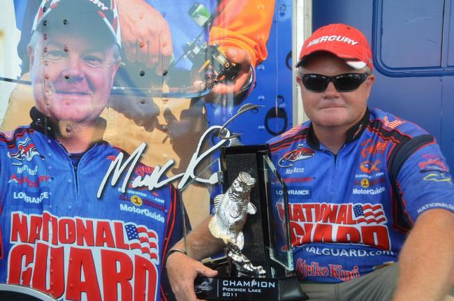 Mark Rose of Marion, Ark., shows off his first-place trophy on Pickwick Lake after winning his first-ever FLW Tour title.