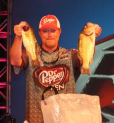 No. 4 pro Kyle Mabrey holds up his two best bass from day three.