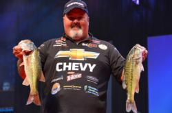 Chevy pro Dion Hibdon proudly displays part of his two-day total catch of 29 pounds. Hibdon currenlty sits in fifth place overall.
