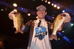 Jacob Wheeler of Indianapolis, Ind., shows off part of his three-day, 48-pound, 2-ounce catch. The 21-year-old continues his vice-like grip on first place at the 2012 Forrest Wood Cup.
