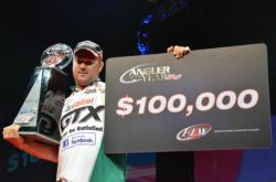 Castrol pro David Dudley shows off his 2012 FLW Tour Angler of the Year bounty.