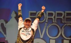 Timothy Dearing of Loudon, Tenn., thrusts his arms into the air after capturing the 2012 Forrest Wood Cup co-angler title.
