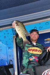 James Mignanelli shows off one of the bass that led him to a third-place finish.