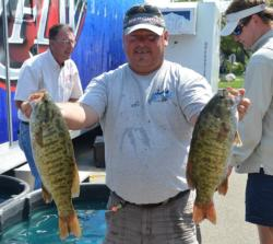 Co-angler leader Dave Hasty holds up a pair of nice smallmouths from day two.