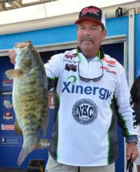 Co-angler Tom Spangler holds up a 6-pound, 7-ounce smallmouth - the Snickers Big Bass from day two.