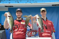 Joseph Zapf and Andrew Zapf of Ramapo College display a few fish from their 12-pound, 14-ounce limit that took home the title at the 2013 FLW College Fishing Northern Division event on Smith Mountain Lake.