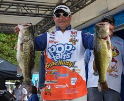 Second-place pro Greg Bohannan holds up two giant Lake Okeechobee largemouths.