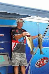 Bryan Schmitt shows off two of his leading fish.