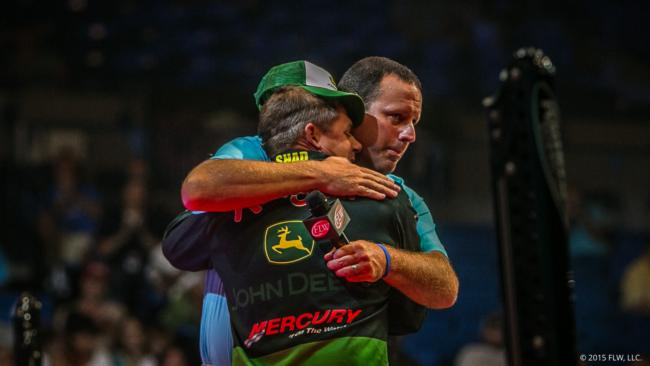 Shad Schenck shares an embrace with FLW Weighmaster Chris Jones after Schenck announced his retirement from fishing.